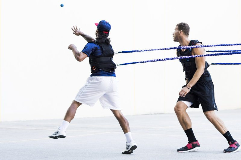 5dc70490c56 NBA player Blake Griffin trains with handball player Timbo at the the West  4th Street handball